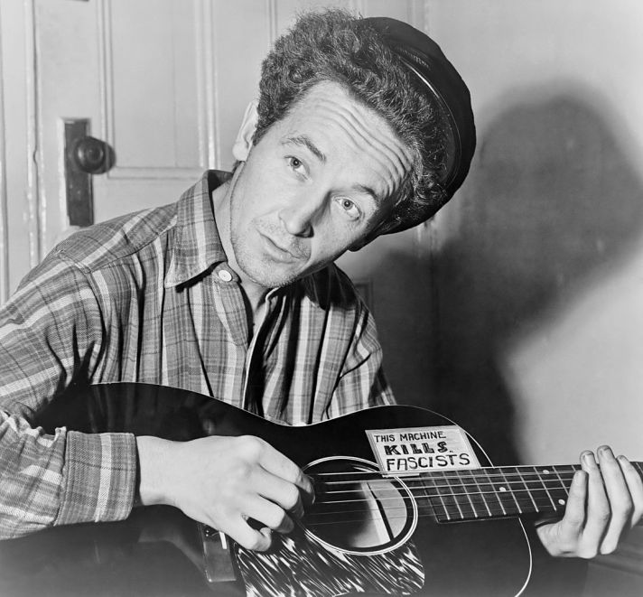 1103px-Woody_Guthrie